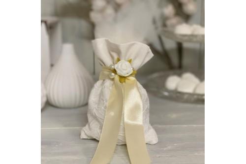 Μπομπονιέρα με πουγκί δανδέλα και λουλούδια